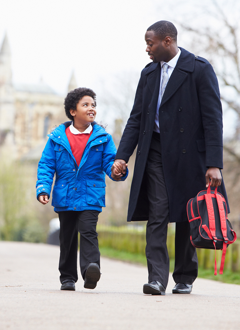 Man walking son to school