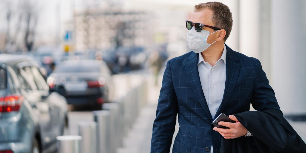 employee commuting and wearing a mask